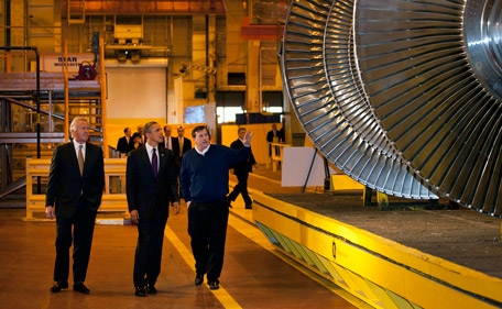 President Barack Obama tours the General Electric plant in Schenectady, N.Y., with Jeff Immelt, CEO and Chairman of General Electric, left,  and Kevin Sharkey, GE Infrastructure/Plant Manager,  Jan. 21, 2011.