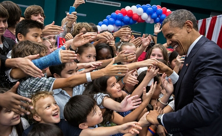 President Barack Obama greets the children of U.S. embassy staff during a reception at the Chulalongkorn University Sports Center in Bangkok, Thailand, Nov. 18, 2012.