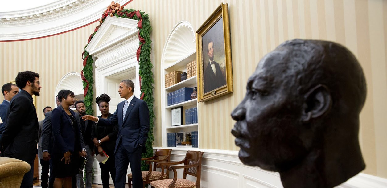 """Following the outcry over the shooting of Michael Brown by a policeman in Ferguson, Missouri, the President invited young civil rights leaders to a meeting in the Oval Office. Many of them had protested in Ferguson. A 30-minute scheduled meeting lasted more than an hour. As the meeting broke up, the President continued the conversation for a few minutes and I then managed to frame the bust of Martin Luther King, Jr. in the foreground."" (Official White House Photo by Pete Souza)"