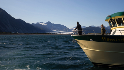 President Obama looks over a rapidly melting glacier in Alaska to bring awareness to the impacts of climate change