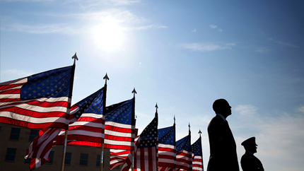 President Obama in front of American flags