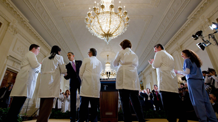 President Obama shakes hands with doctors at an event in the White House