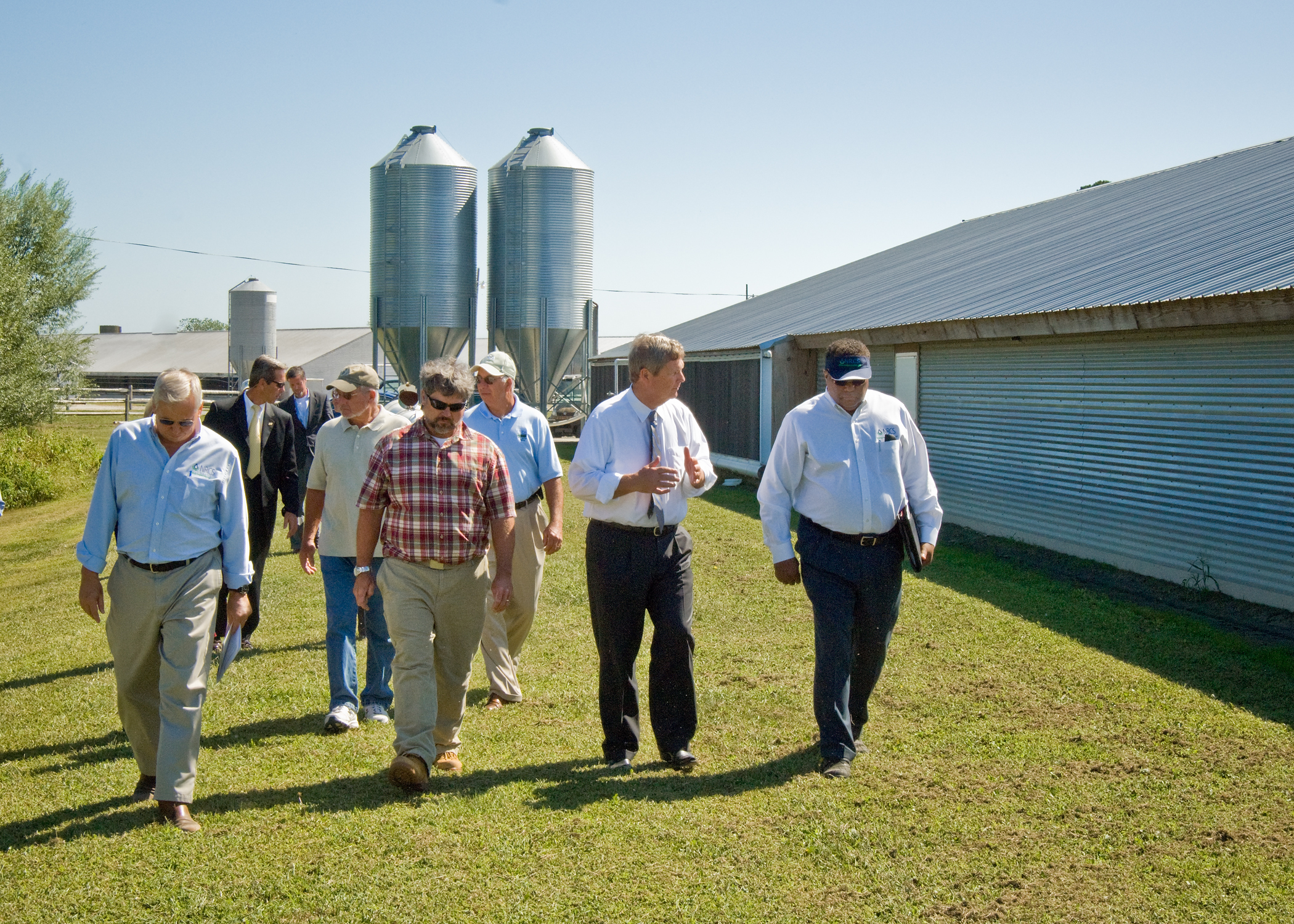 A group takes a walking tour of Double B Farms on Monday, September 20, 2010.