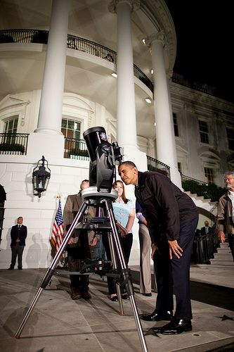 President Obama looks through a telescope during the 2009 White House Astronomy Night.