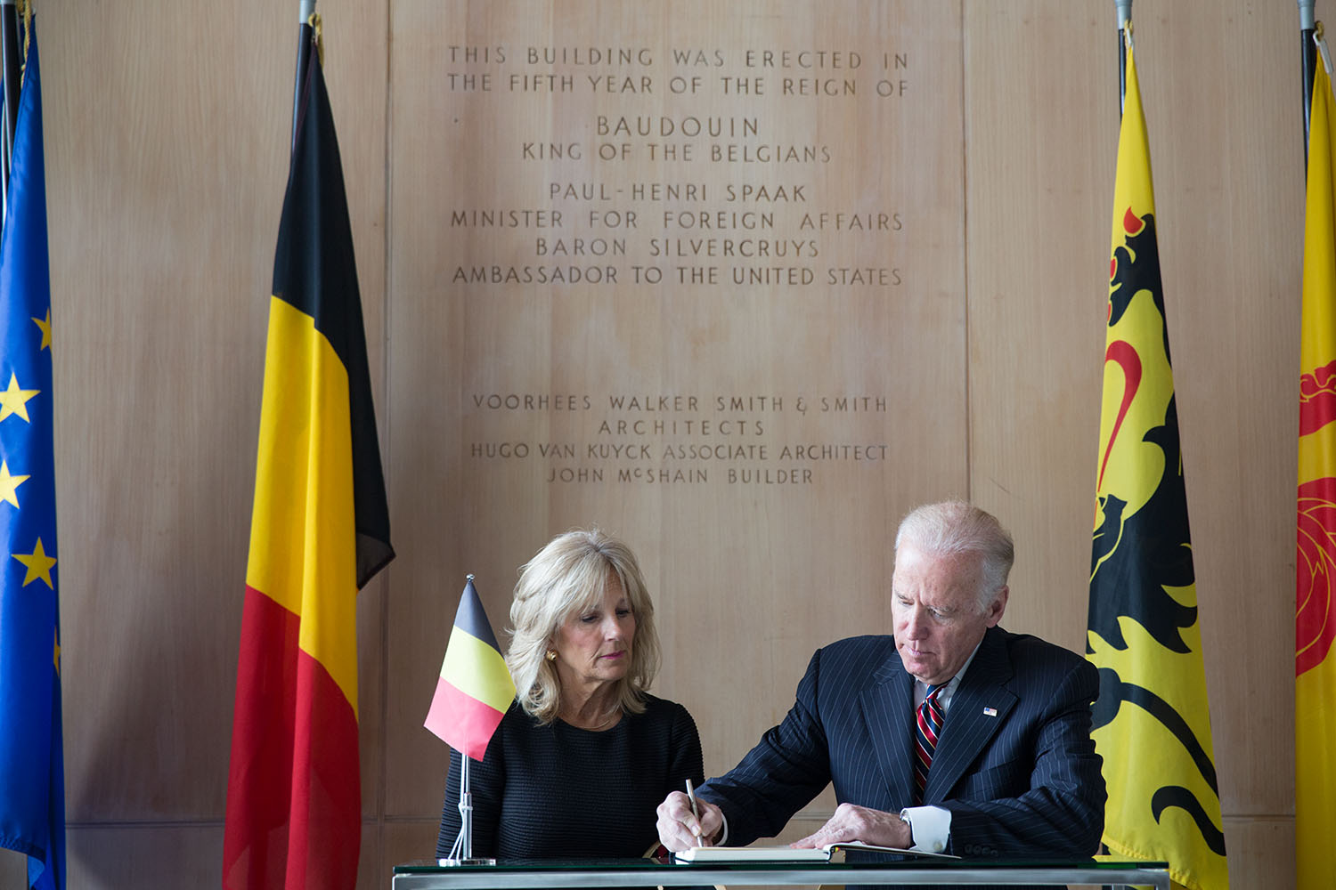 The Bidens sign the guestbook at the Belgian Embassy