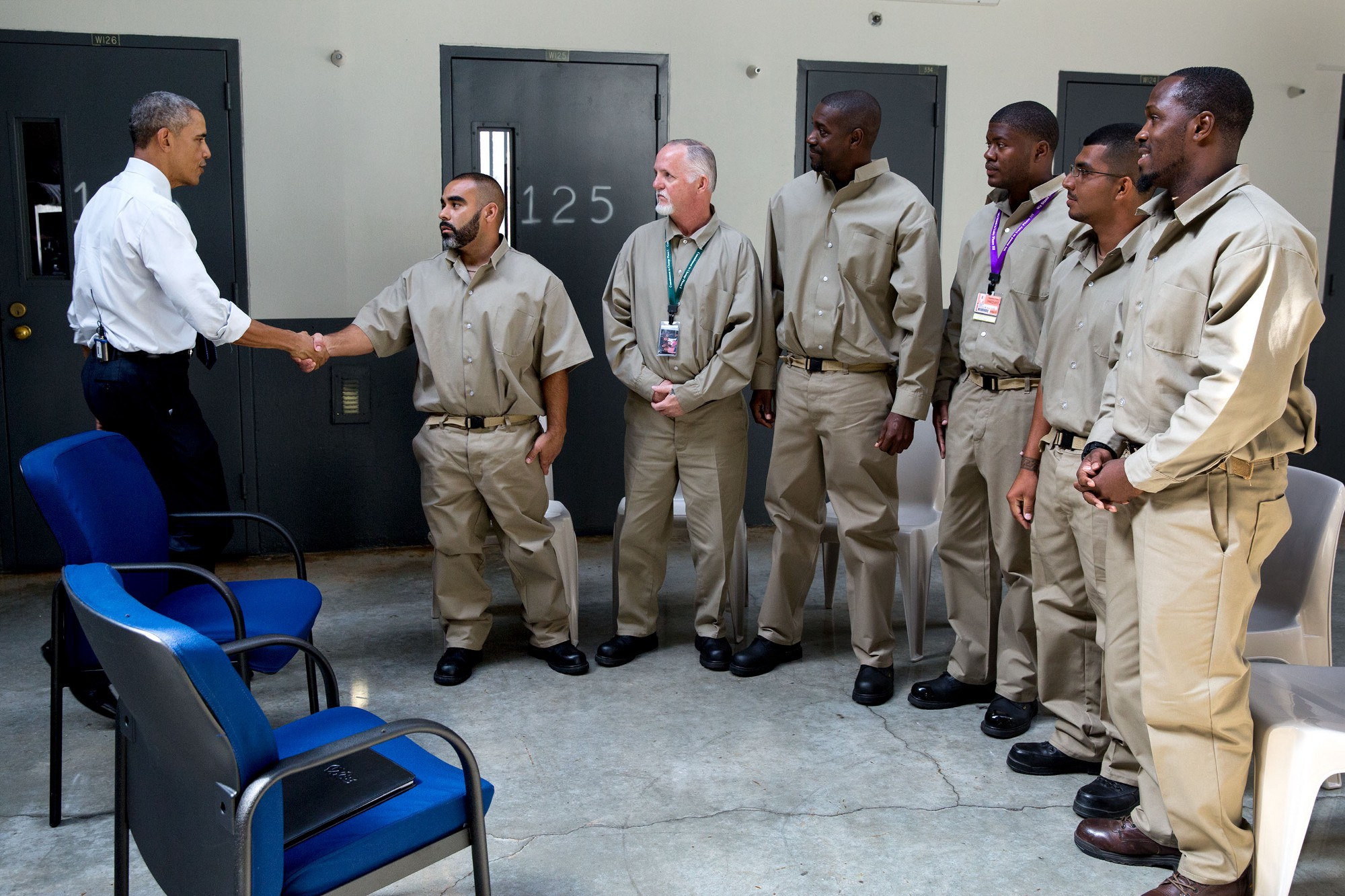 President Obama greets inmates. (Official White House Photo by Pete Souza)