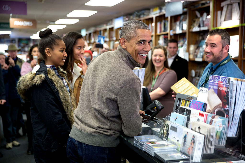 President Barack Obama and daughters Sasha and Malia shop for books at Politics and Prose in Washington, D.C., on Small Business Saturday, Nov. 29, 2014. (Official White House Photo by Pete Souza)