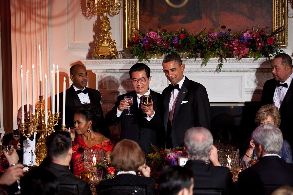 President Barack Obama and President Hu Jintao of China toast during the State Dinner in the State Dining Room of the White House, Jan. 19, 2011. (Official White House Photo by Lawrence Jackson)