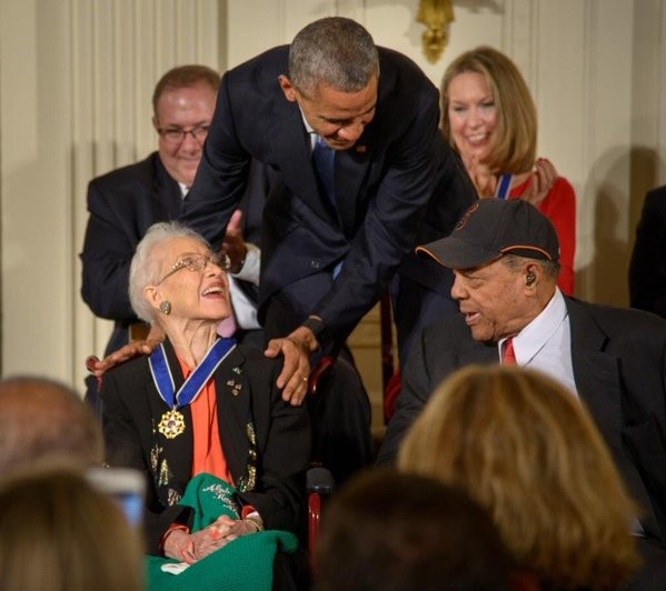 President Barack Obama presents former NASA mathematician Katherine Johnson with the Presidential Medal of Freedom, as professional baseball player Willie Mays, right, looks on, Tuesday, Nov. 24, 2015, during a ceremony in the East Room of the White House in Washington. (Photo Credit: NASA/Bill Ingalls).