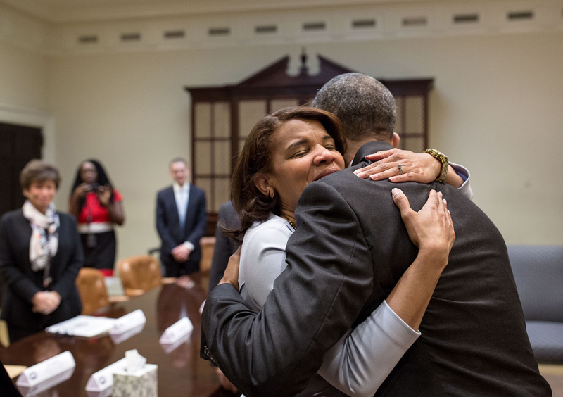 President Barack Obama hugs Kemba Smith during a greet with formerly incarcerated individuals