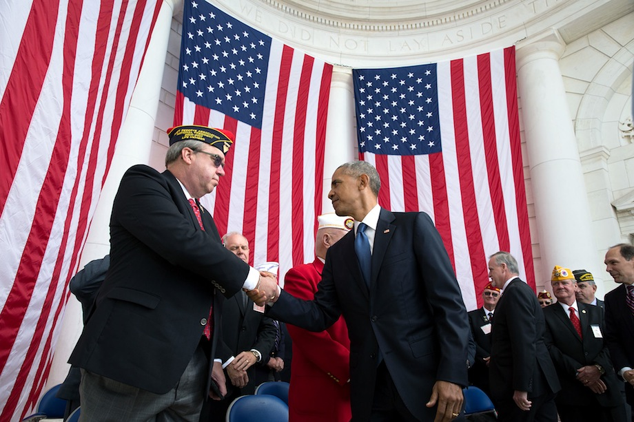 President Barack Obama shakes the hand of Donald E. Larson, National President of the Fleet Reserve Association, after delivering remarks during a Veterans Day ceremony at the Memorial Amphitheater at Arlington National Cemetery in Arlington, Virginia, Nov. 11, 2016. (Official White House Photo by Pete Souza)