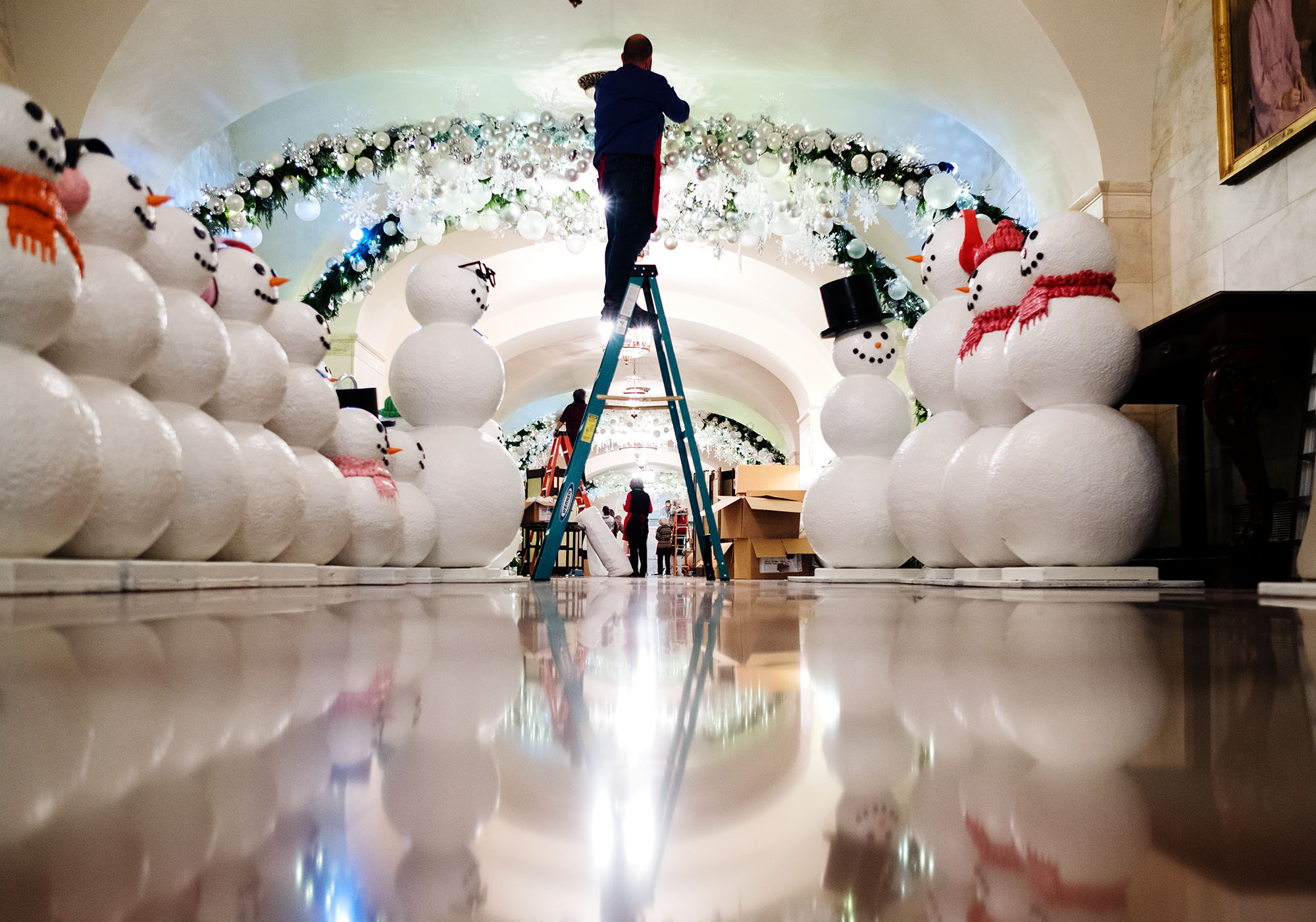 volunteers and staff work on holiday decorations in the lower cross hall of the white house - White House Christmas Decorations 2016