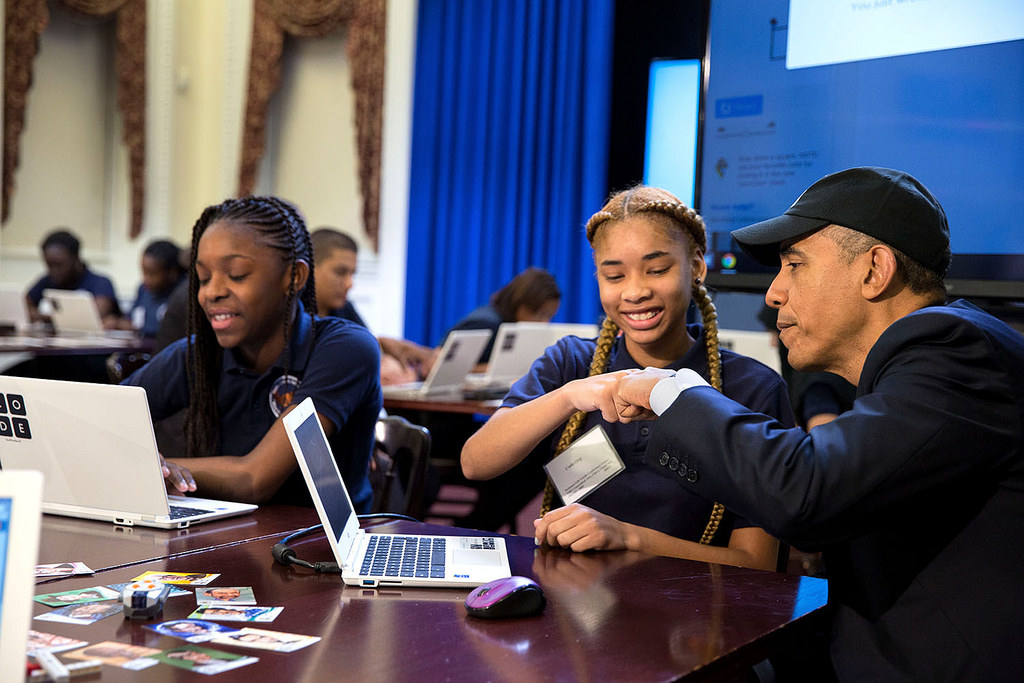 "President Barack Obama fist bumps a middle-school student participating in an ""Hour of Code"" event to honor Computer Science Education Week in the Eisenhower Executive Office Building, Dec. 8, 2014. (Official White House Photo by Pete Souza)"