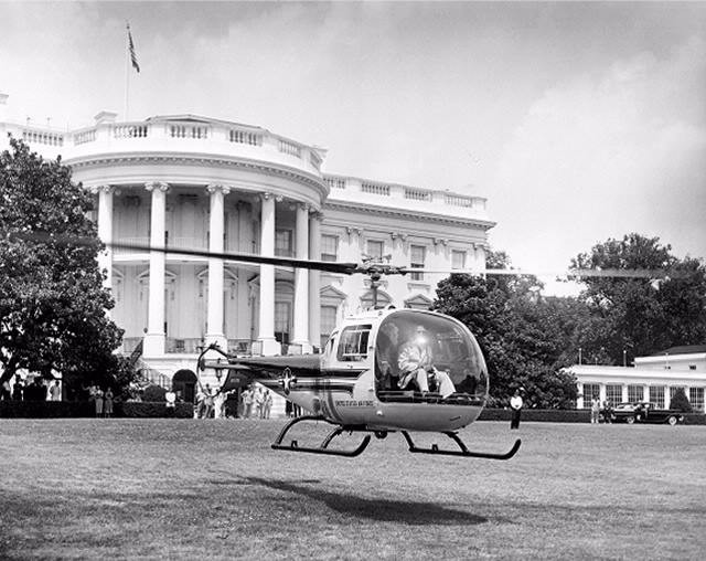 President Eisenhower departs the White House on July 15, 1957 in a two-passenger Bell H-13J helicopter.
