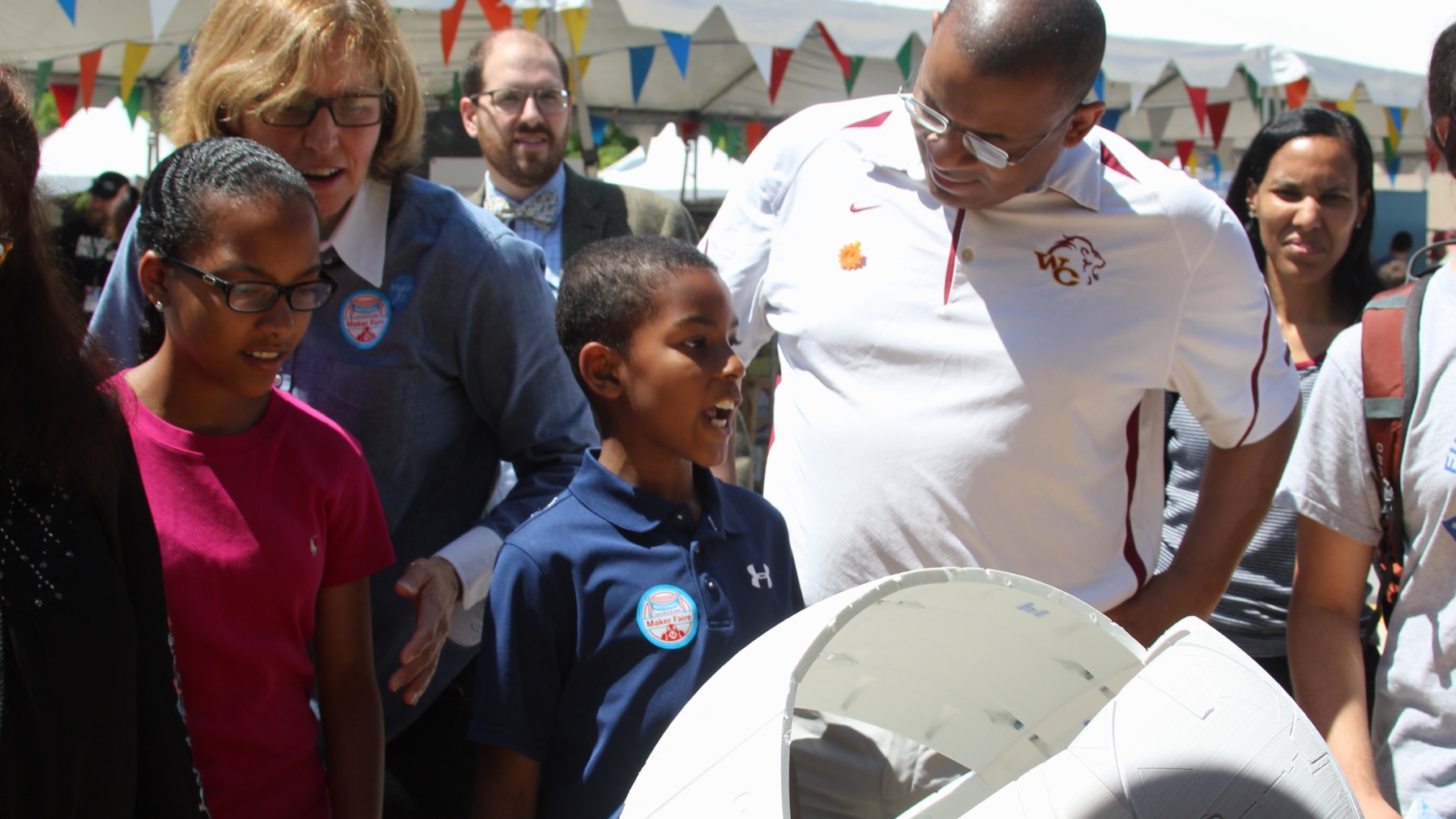 U.S. Chief Technology Officer Megan Smith and Secretary of Transportation Anthony Foxx examined a DIY-replica of the popular BB-8 robot during the National Maker Faire at University of the District of Columbia, June 18, 2016. (Photo Credit: Tyler Daniels)