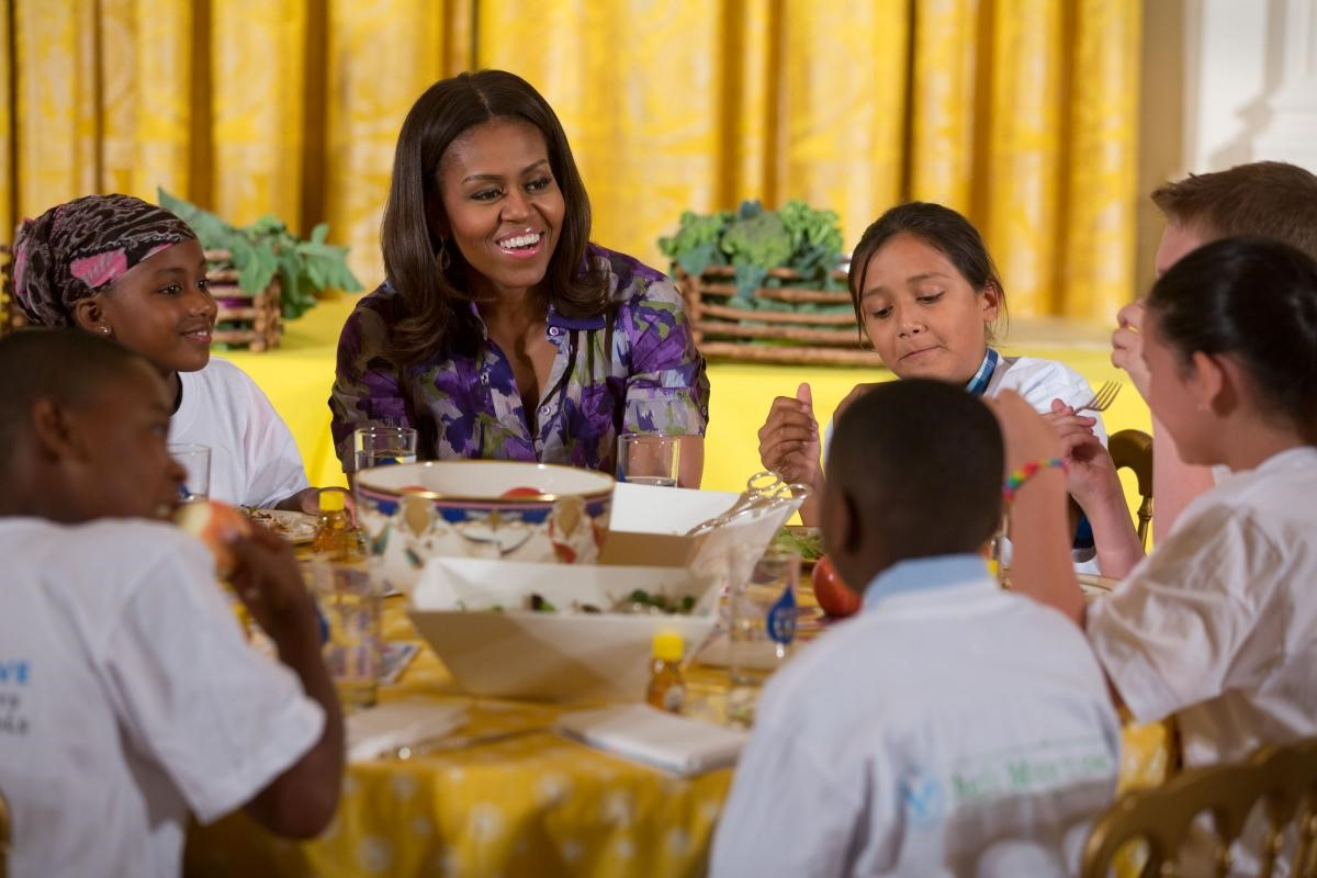 "First Lady Michelle Obama and students from across the country who participate in the ten ""Let's Move!"" sub-initiative programs eat the food they have prepared during a White House Kitchen Garden harvest event in the East Room of the White House, June 3, 2015. (Official White House Photo by Lawrence Jackson)"