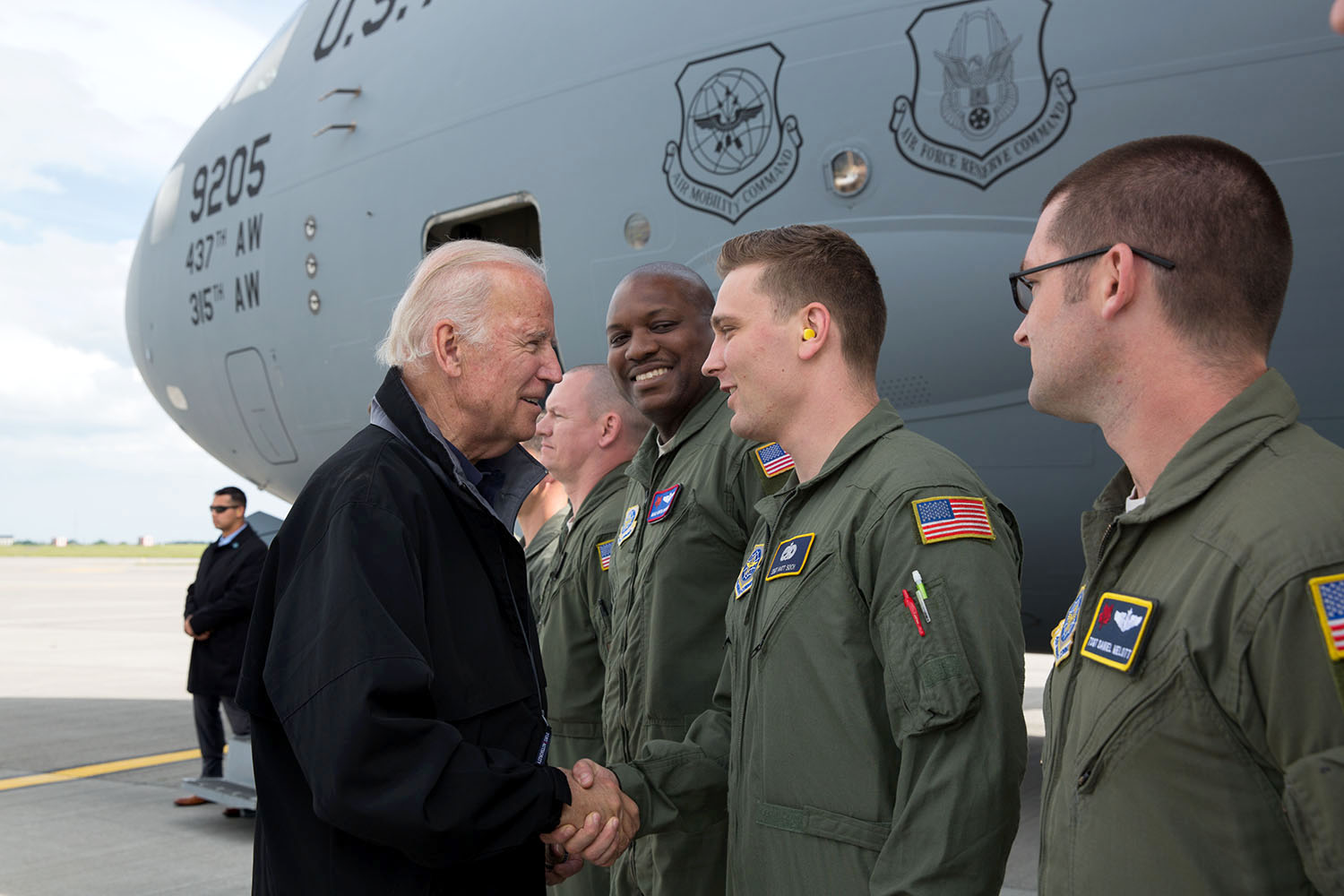 Vice President Joe Biden shakes hands with crew members outside a C-17 serving as Air Force Two, at Dublin International Airport, in Dublin Ireland, June 23, 2016. (Official White House Photo by David Lienemann)