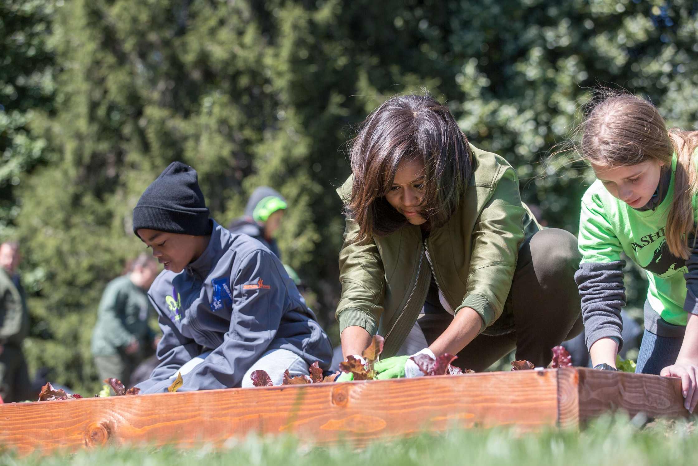 First Lady plants with students