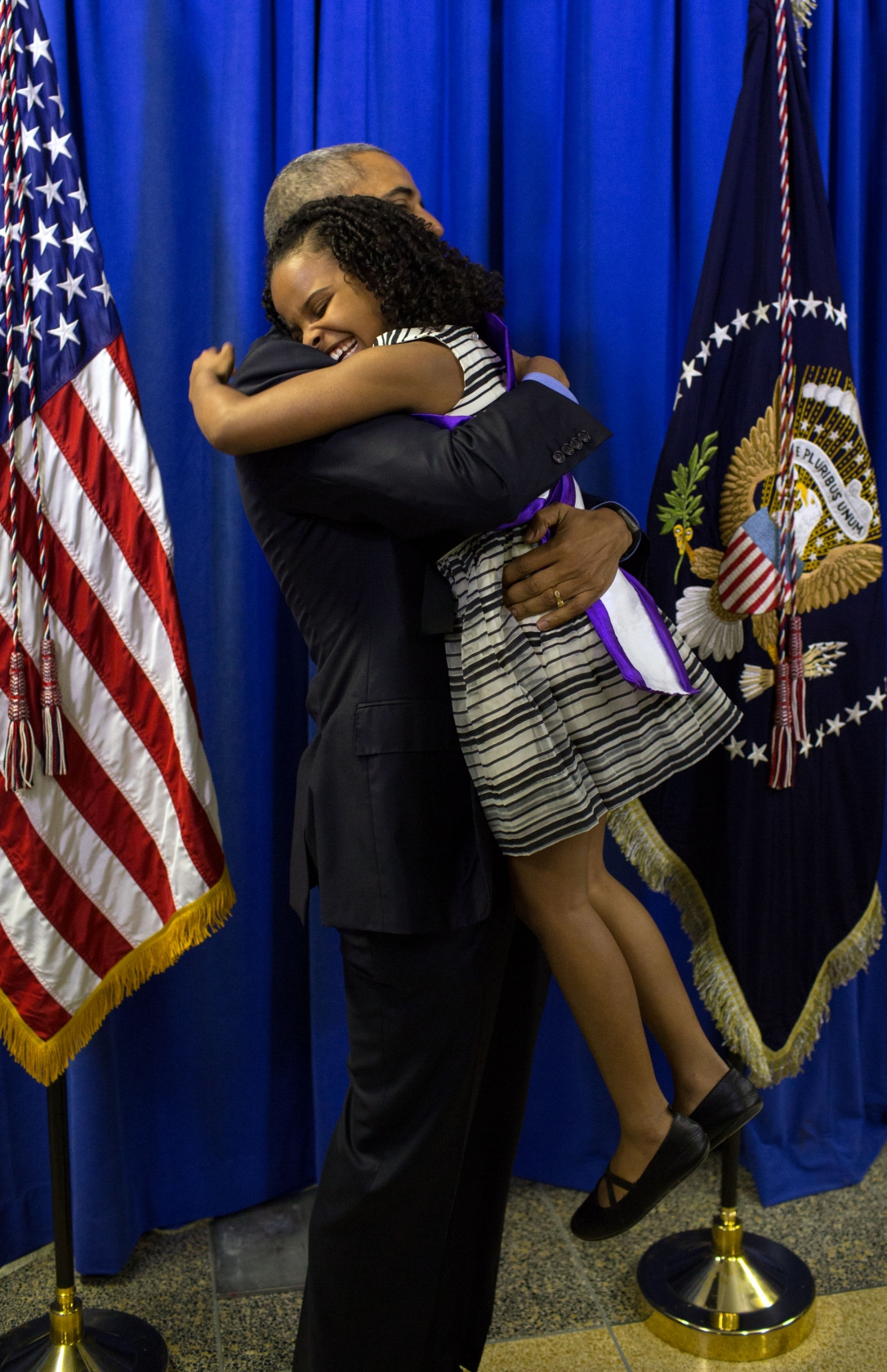 President Barack Obama hugs Mari Copeny, 8, backstage at Northwestern High School in Flint, Mich., May 4, 2016. Mari wrote a letter to the President about the Flint water crisis. (Official White House Photo by Pete Souza)