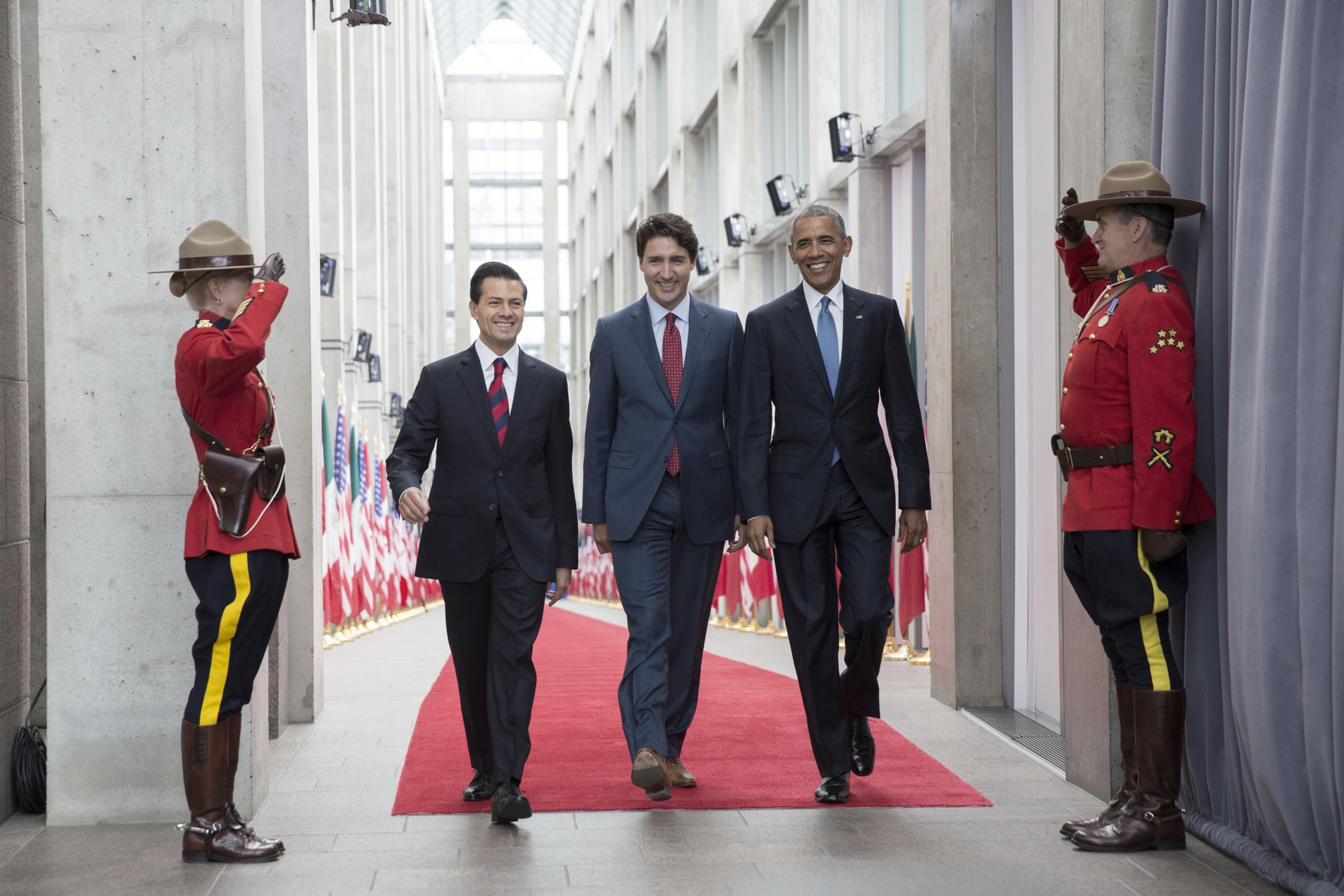President Barack Obama and Prime Minister Justin Trudeau of Canada greet President Enrique Peña Nieto of Mexico upon arrival for the North American Leaders' Summit at the National Gallery of Canada in Ottawa, Canada, June 29, 2016. (Official White House Photo by Lawrence Jackson)