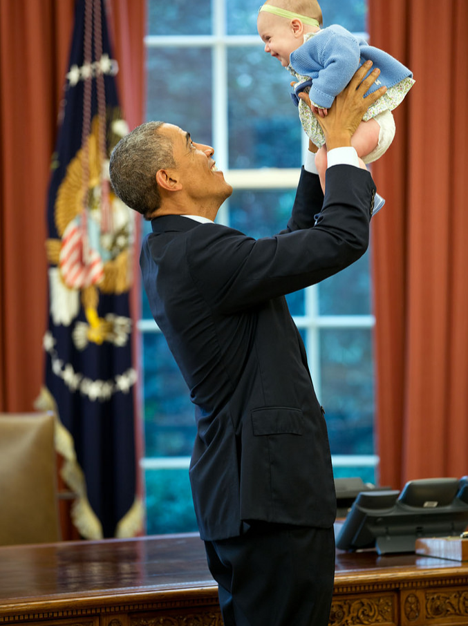 President Obama with a child.