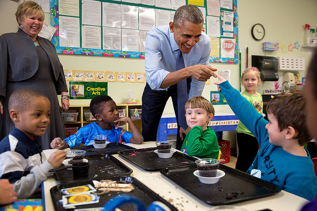 President Barack Obama and a young student touch fingers during a visit to the Community Children's Center, one of the nation's oldest Head Start providers, in Lawrence, Kan., Jan. 22, 2015. (Official White House Photo by Pete Souza)