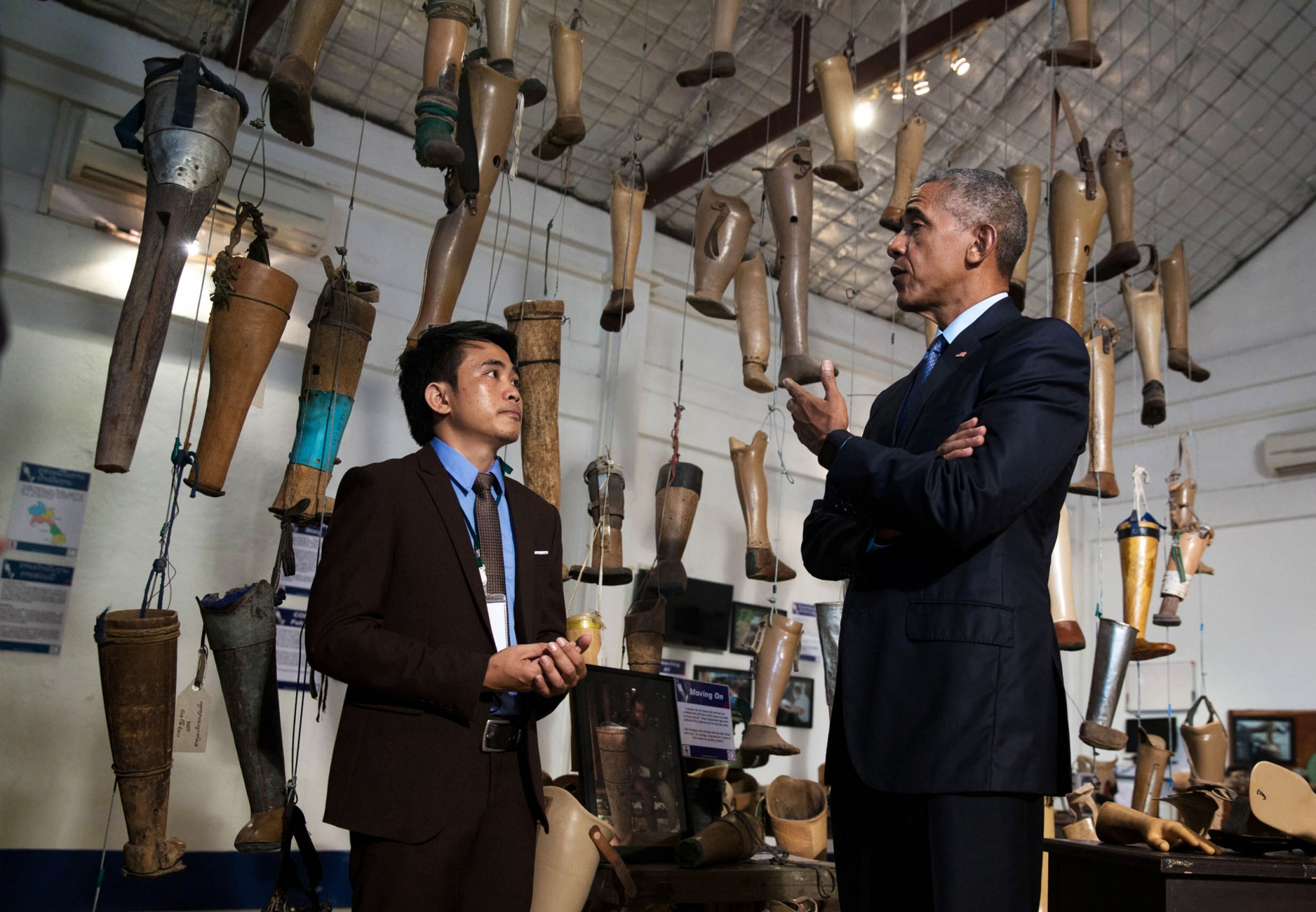 President Barack Obama meets with unexploded ordnance survivor Thoummy Silamphan from the Quality of Life Association, as he tours the Cooperative Orthotic Prosthetic Enterprise (COPE) Visitor Centre to meet with unexploded ordnance clearance teams and survivors of blasts, in Vientiane, Laos, Sept. 7, 2016. (Official White House Photo by Chuck Kennedy)