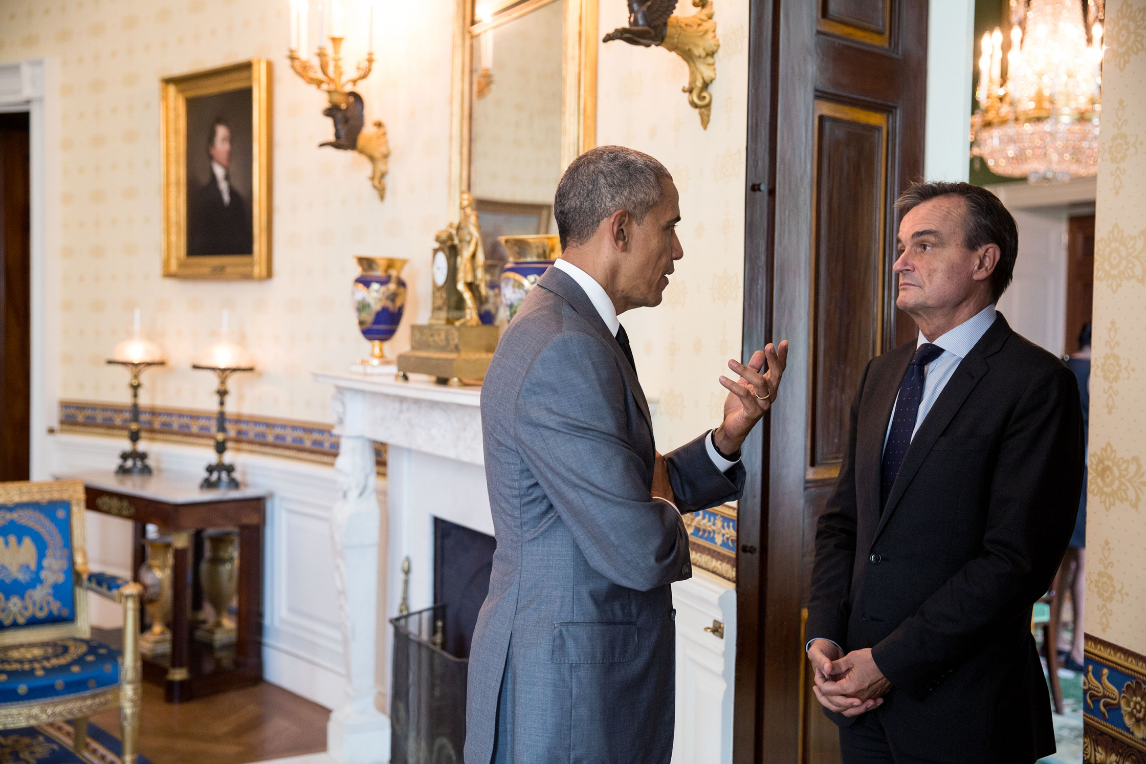 President Barack Obama talks with Ambassador of France to the United States Gérard Araud in the Blue Room of the White House prior to the Diplomatic Corps Reception, July 15, 2016.