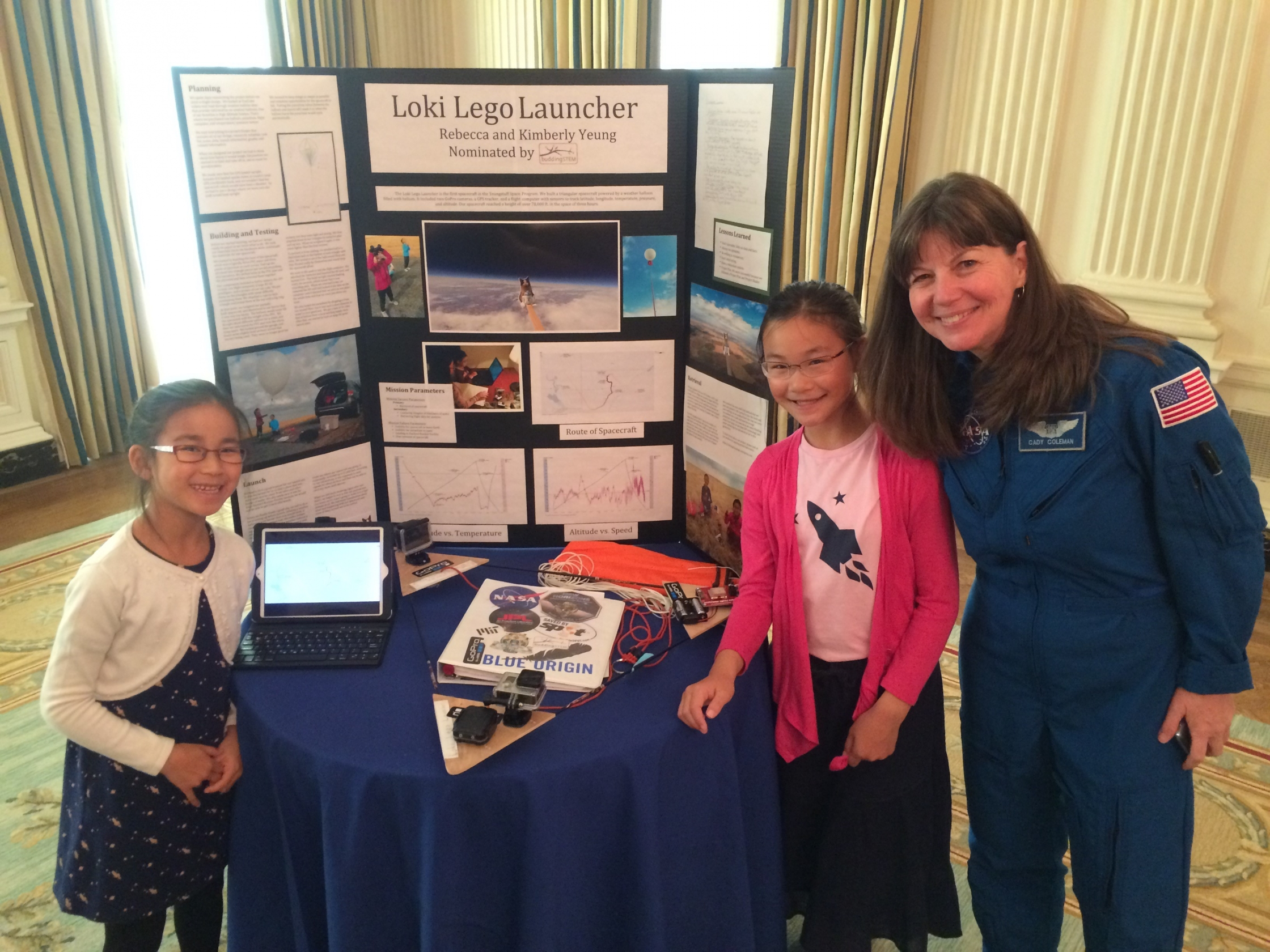 Kimberly (left) and Rebecca Yeung of Seattle, WA, ages 9 and 11, pose with astronaut Cady Coleman at the 2016 White House Science Fair. (Photo credit: Jenn Gustetic)