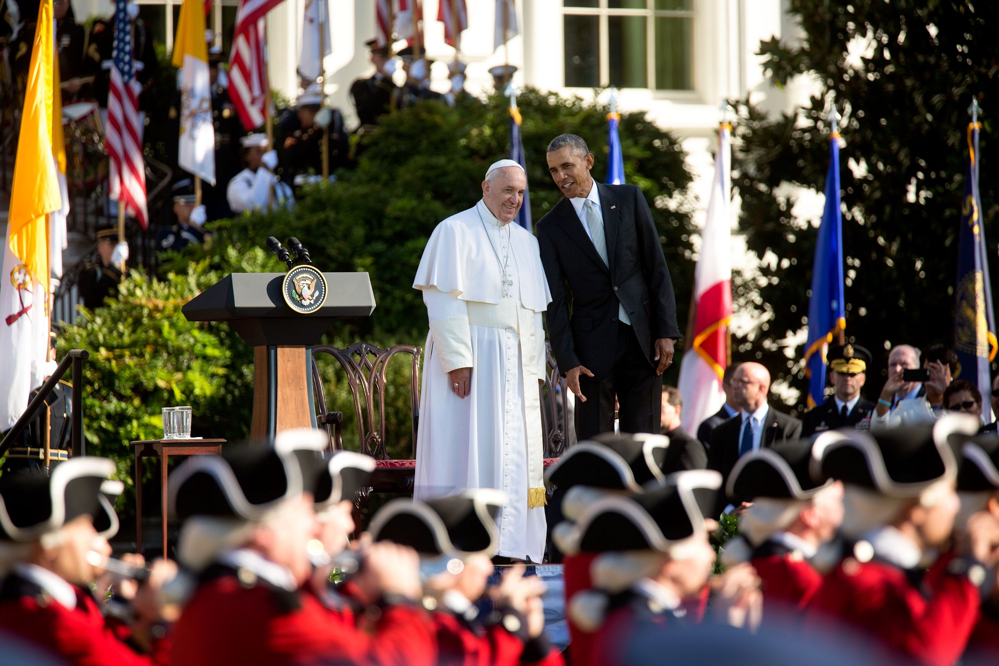President Obama talks to Pope Francis as the Army Fife and Drum Corps march. (Official White House Photo by Lawrence Jackson)