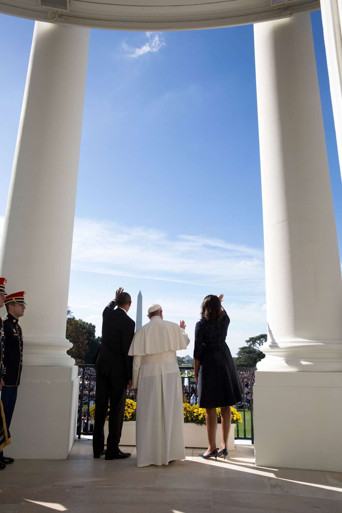 The Pope waves from the Blue Room Balcony with the President and First Lady. (Official White House Photo by Pete Souza)