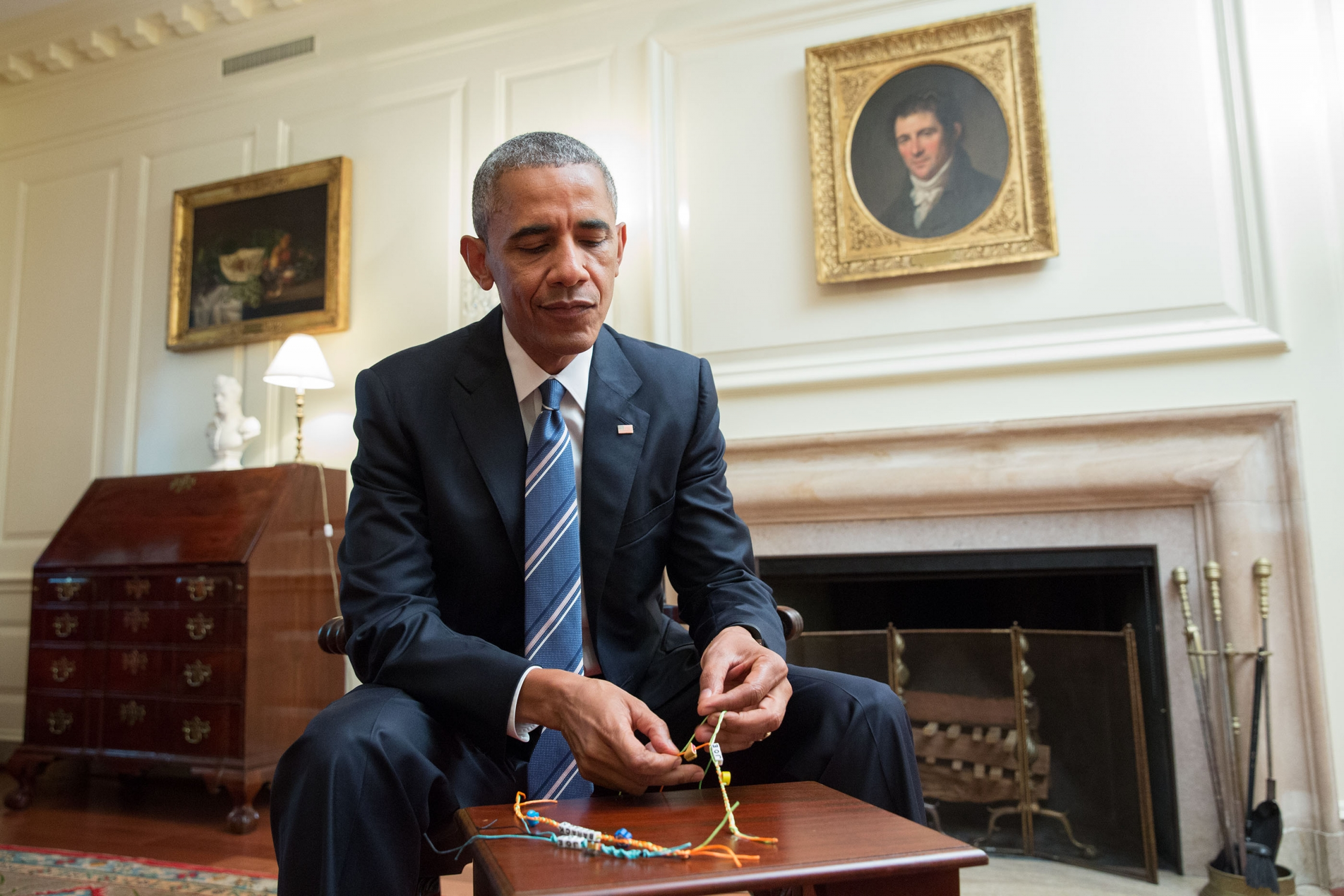 President Barack Obama makes a friendship bracelet while taping a video for Buzzfeed's TurnUptoVote Week, in the Map Room of the White House, June 23, 2016. (Official White House Photo by Amanda Lucidon)