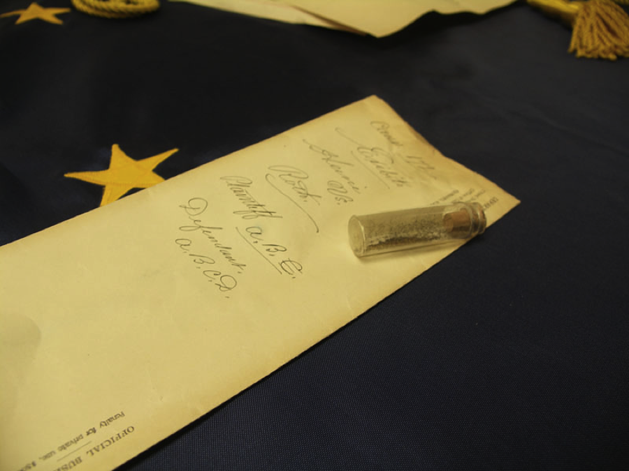 A vial of gold found in the case file of Heine v. Roth in the National Archives at Anchorage