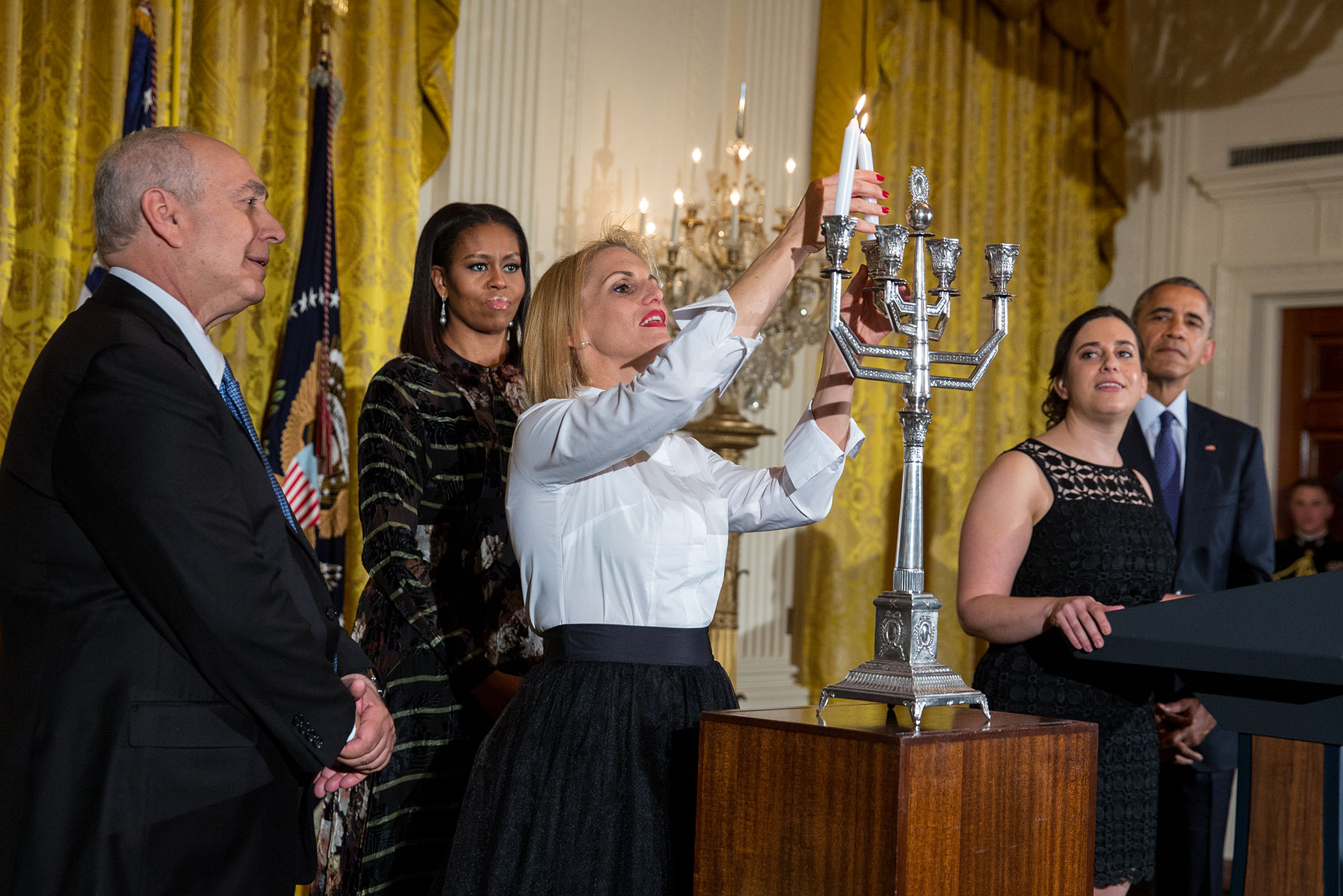 President Barack Obama, First Lady Michelle and Rabbi Rachel Isaacs join Chemi Peres and Mika Almog for the menorah lighting during Hanukkah in the East Room of the White House, Dec. 14, 2016. (Official White House Photo by Chuck Kennedy)