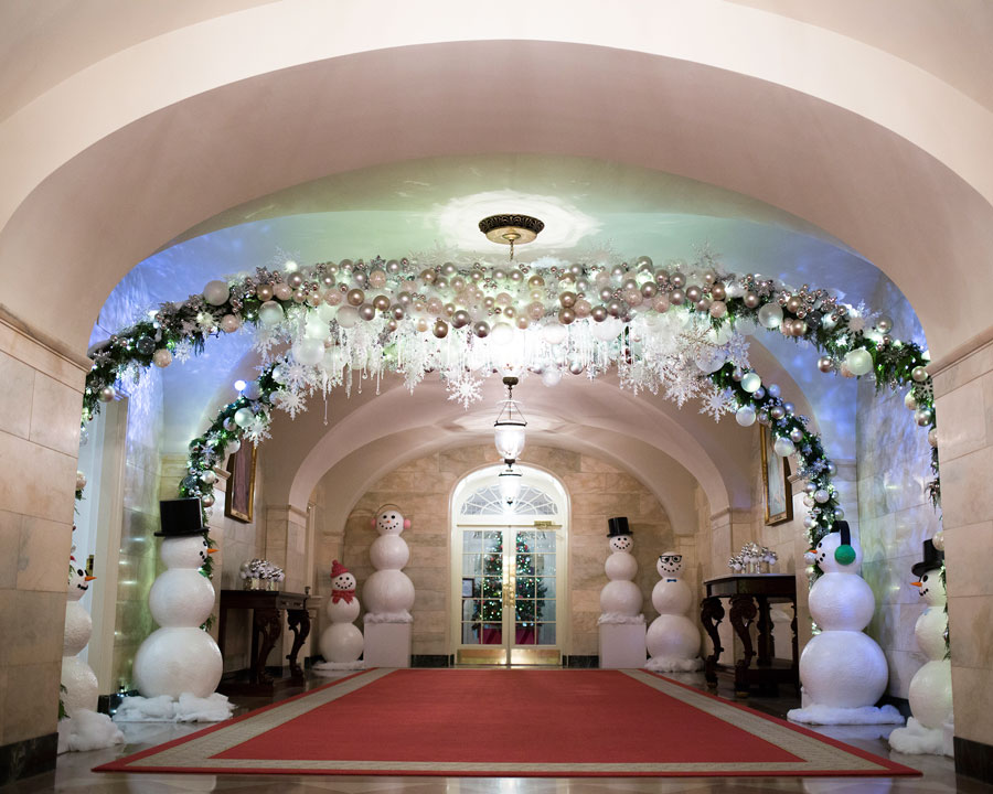 the east colonnade is decorated with crystals hanging in the air like snowflakes ribbons cascading