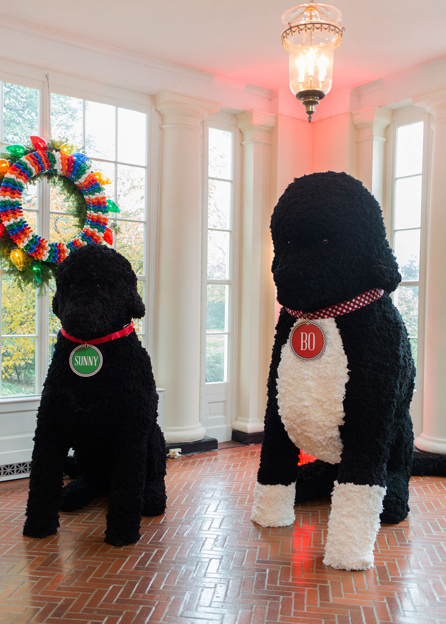 Large representations of the First Family's dogs, Bo and Sunny, stand on the East Landing.