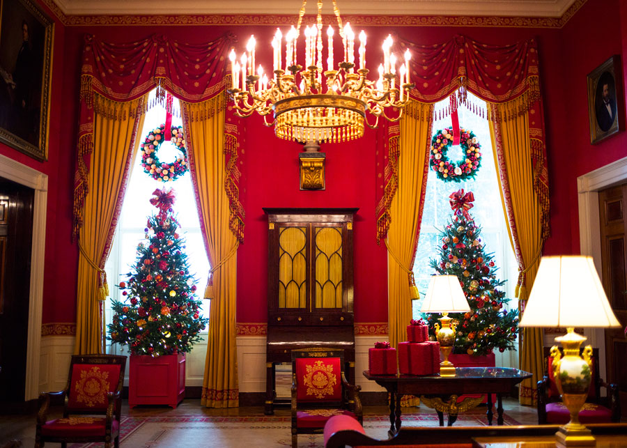 resting atop a table cranberries create gift boxes in festive celebration and placed in - White House Christmas Decorations 2016
