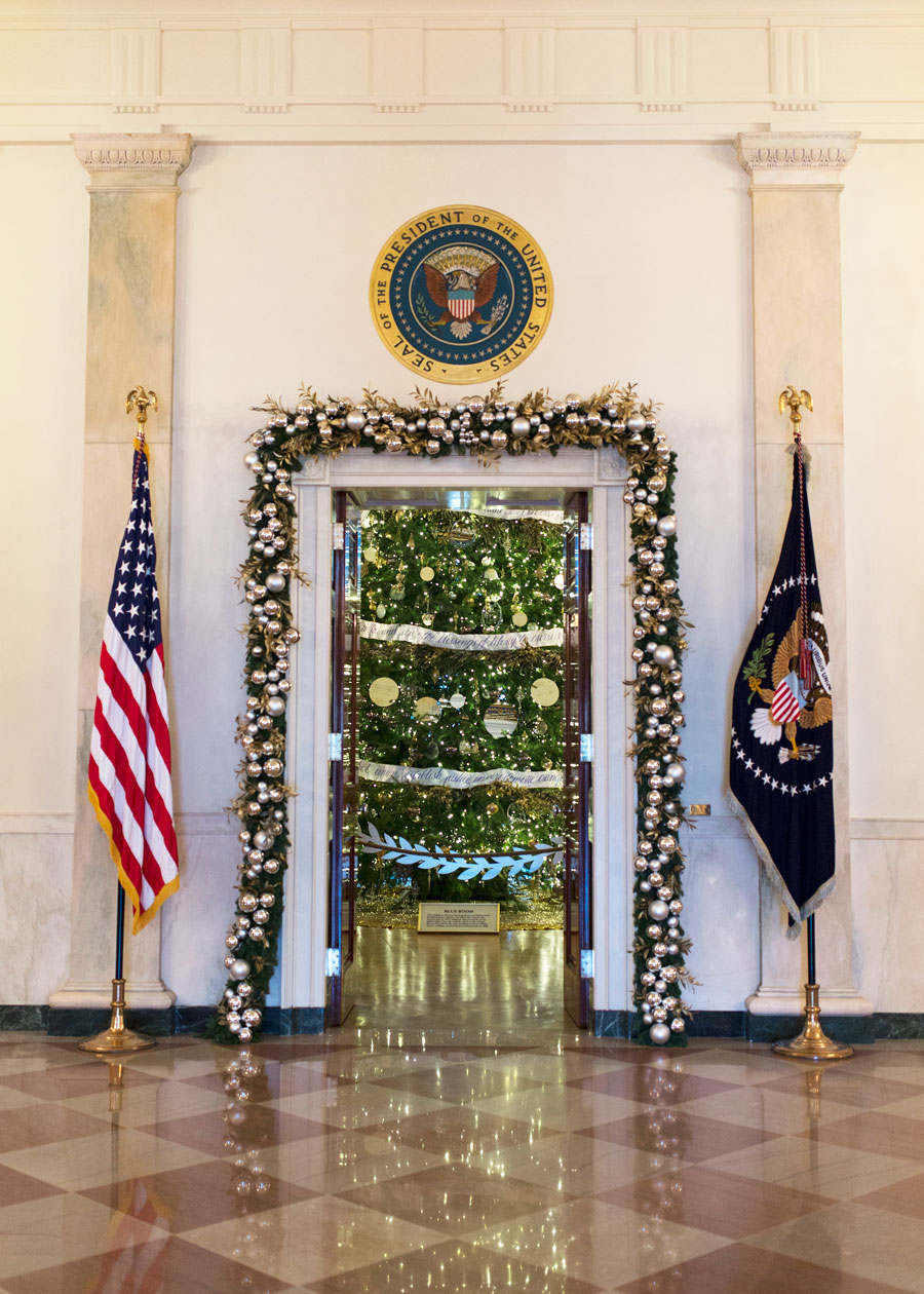 door leading to the blue room is decorated with garland with a sneak peek of - White House Christmas Decorations 2016