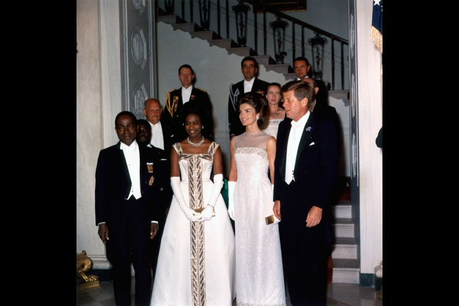 State Dinner for the President Houphouet-Boigny of the Ivory Coast. L-R, President and Madame Houphouet-Boigny, President and Mrs. Kennedy at the Grand Staircase. 5/22/62.