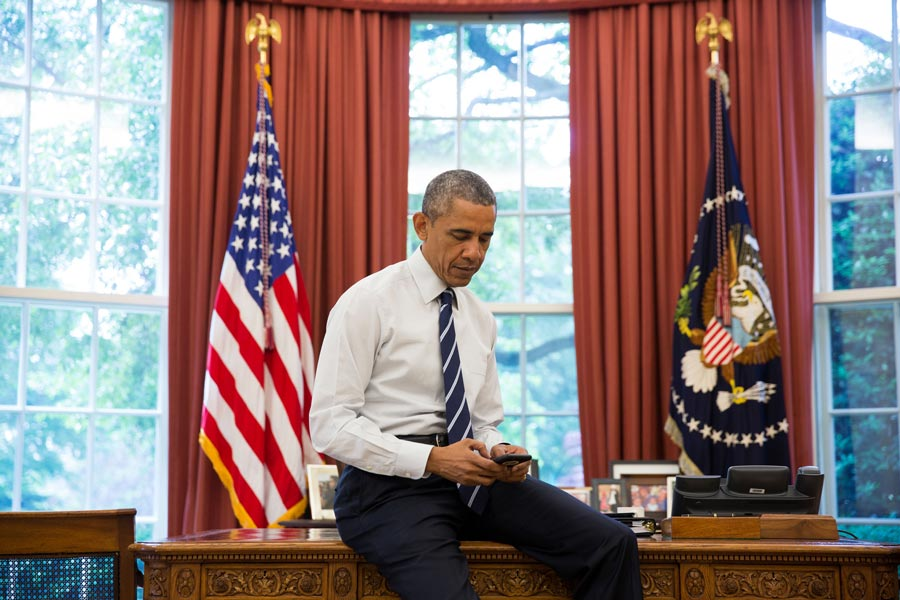 President Obama on his iPhone