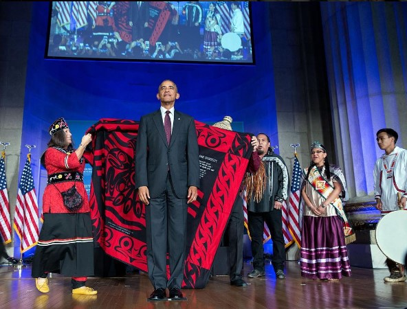 President Barack Obama being honored with a blanket ceremony and song during the 8th White House Tribal Nations Conference in Washington, D.C., September 29, 2016.
